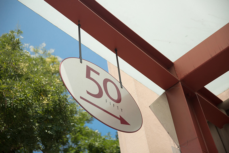 Sign for entrance to building with the number 50
