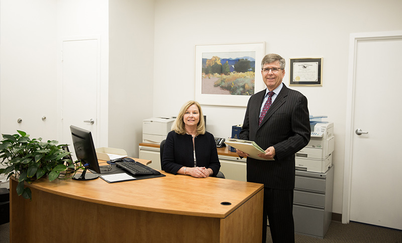 Attorney Doug and his assistant Trish at the entrance of the law firm