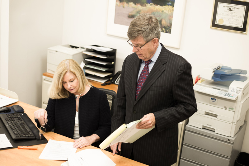 Doug and his assistant Trish work on a case file together