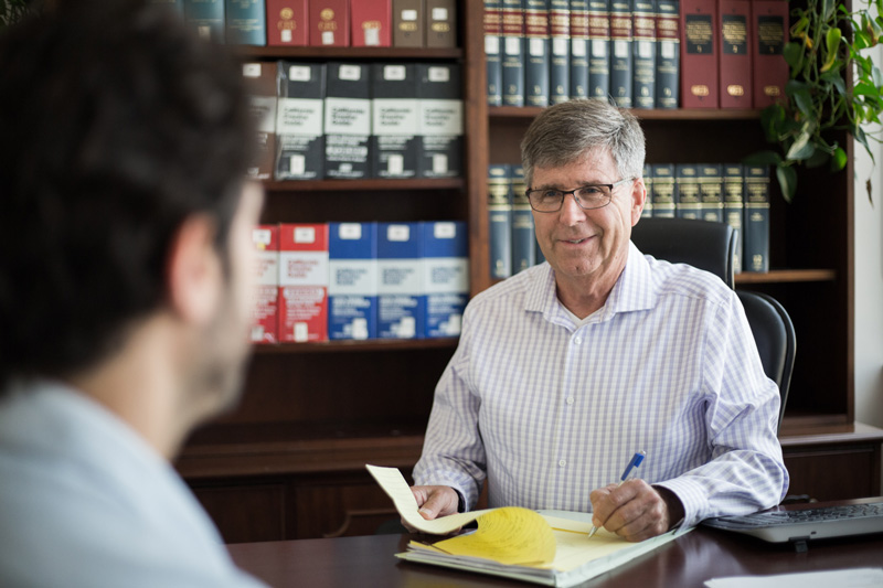 Doug meet with a client in his office